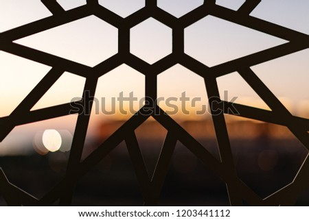 Fence with a floral pattern and stars at sunset. Oriental patterns. Turkish patterns and backgrounds #1203441112