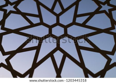 Fence with a floral pattern and stars at sunset. Oriental patterns. Turkish patterns and backgrounds #1203445318