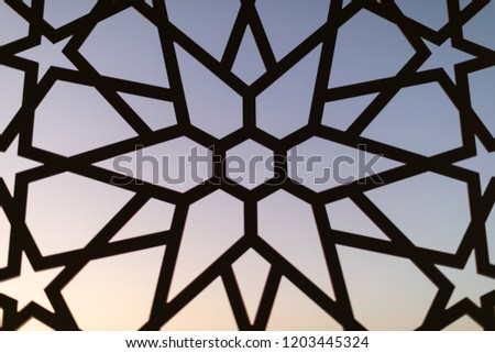 Fence with a floral pattern and stars at sunset. Oriental patterns. Turkish patterns and backgrounds #1203445324