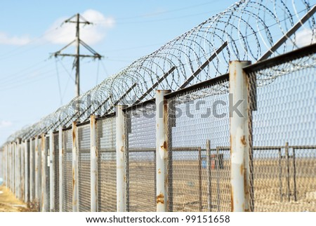 Fence with barbed wire (small depth of sharpness)