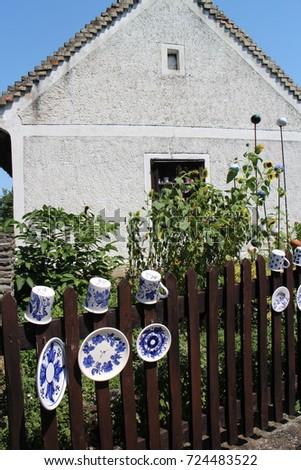Fence with cups and plates on Tihany Peninsula, Balaton, Hungary  #724483522
