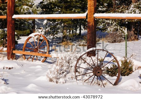 Fence with wagon wheels in snow
