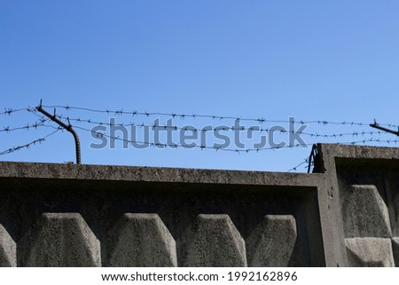 Fenced area. Prison fence. Protection from thieves. Foto stock ©