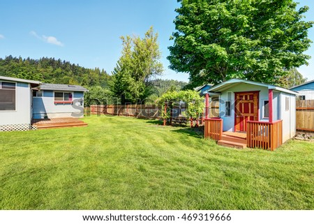 Fenced backyard with barn shed and hanging swing with nice landscape desing. Northwest, USA