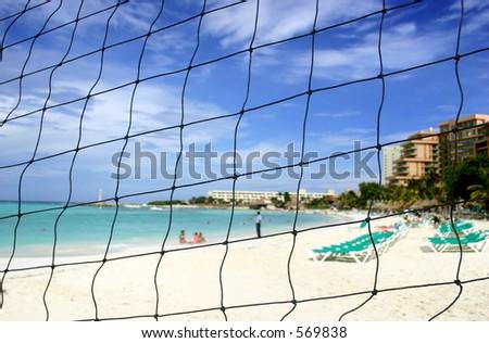 Fenced off area of tropical beach