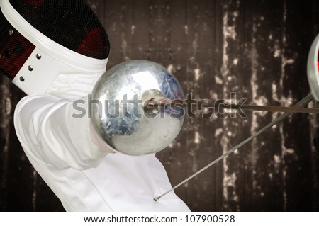 fencer athlete with sword and mask in action