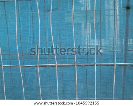 fences covered with blue transparant gauze: a see through #1045592155