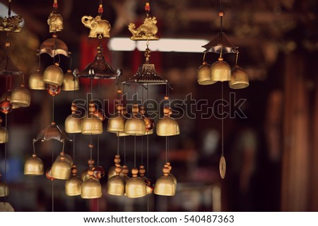 Feng Shui chimes hanged outside the house for protection and good luck #540487363