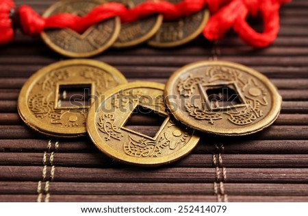 Feng shui coins on table close-up #252414079