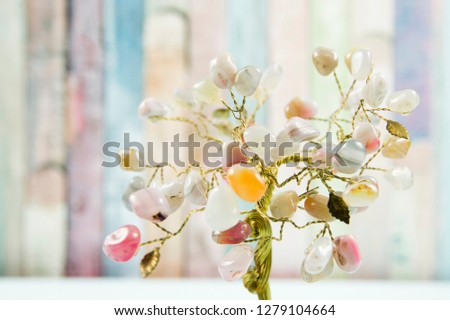 Feng shui gem tree, also called feng shui crystal tree is used for spiritual feng shui cures for love to feng shui for money. Isolated on colorful pastel wooden board background. #1279104664