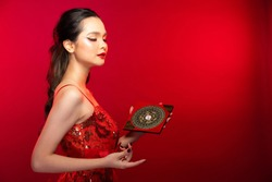 Feng Shui Master Red Woman show FengShui Compass and turn direction to Force Energy, Many Chinese Texts on Compass translate as North South West East Luck Prosperity on Wind Water elements Flow