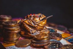 Feng Shui money toad. Chinese frog for money with a coin.
