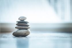 Feng Shui: Stone cairn on the wooden floor, text space and cool light