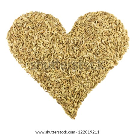 Fennel Seeds in the shape of a Heart isolated on white with clipping path
