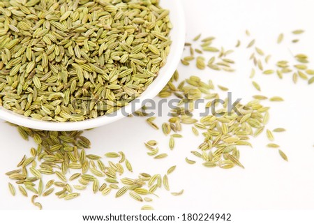 Fennel seeds in white bowl
