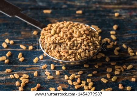 Fenugreek Seeds Spilled from a Teaspoon