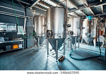 Fermentation mash vats or boiler tanks in a brewery factory. Brewery plant interior.  ストックフォト ©