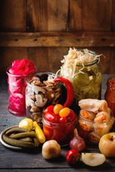 fermentation vegetables in a jars on a woodenbackground