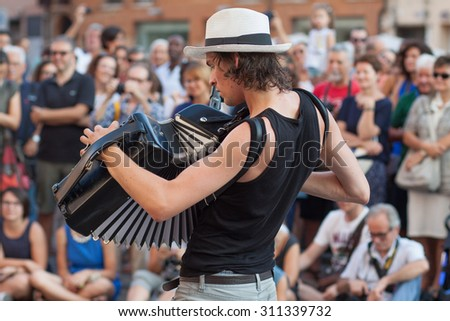 FERRARA, Italy - August 29, 2015: Buskers Festival 2015 in Ferrara, Emilia Romagna, Italy. Busker Festival is a popular event with street artists which is held annually in the center of Ferrara