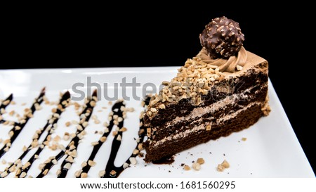 Ferrero Rocher Cake with sprinkles and sauce Photo stock ©