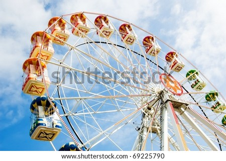 ferris wheel against a blue sky
