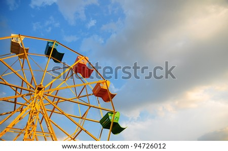 ferris wheel against a blue sky background