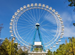 Ferris wheel against a blue sky on a sunny day - Moscow, Russia