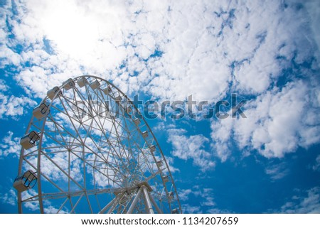 Ferris wheel against the blue sky #1134207659