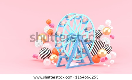 Ferris wheel among colorful balls on a pink background.-3d rendering.