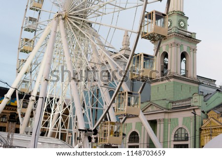 Ferris wheel and Temple of St. Catherine, Kyiv, Ukraine. The place where the old and the new city met.