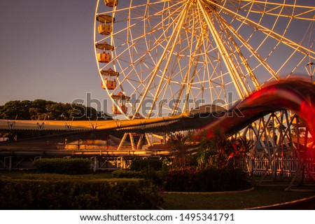 "Ferris wheel and toy called ""big worm"" - a species of small roller coaster - in Guanabara Park, Pampulha, Belo Horizonte, Minas Gerais"