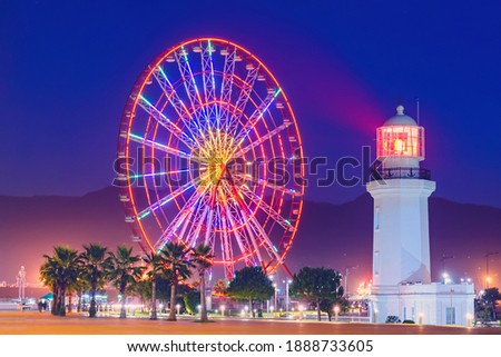 Ferris wheel at amusement theme park in the evening time. Batumi Boulevard. Photo is taken with a long exposure and has motion blur.  Photo stock ©
