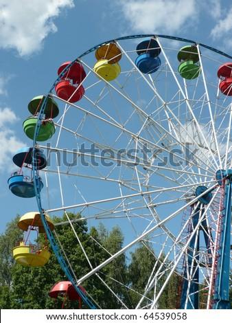 Ferris wheel at dry sunny summer day #64539058