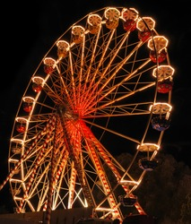 Ferris wheel at the fair ground at night.