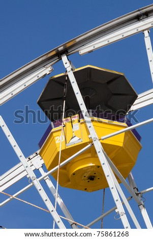 Ferris Wheel Car Isolated on Clear Blue Sky Background