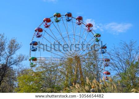 Ferris wheel. Ferris wheel in the city park. Seats for passengers on the ferris wheel.