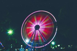 Ferris wheel in an amusement park, Ferris Wheel in Night, Long exposure of ferris wheel, Colourful light trails, Long exposure of a ferris wheel ride at night