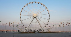 Ferris wheel in front of sky. Big carousel in Baku