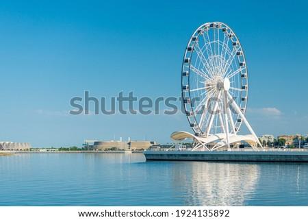 Ferris wheel in front of sky. Big carousel in Baku, Azerbaijan