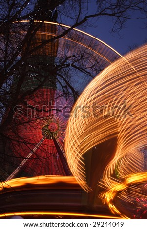 Ferris Wheel in front of Walter Scott Monument, Edinburgh, Scotland - stock photo