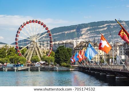 Ferris wheel in Geneva in a beautiful summer day, Switzerland #705174532