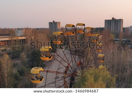 Ferris wheel in the City of Pripyat at sunset time. Apocalyptic city of Pripyat after a nuclear explosion at a nuclear power plant. Chernobyl disaster.