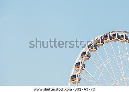 Ferris wheel on a bright sunny day #381743770