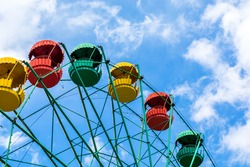 Ferris Wheel Over Blue Sky . Big wheel