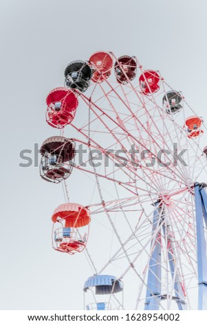 Ferris wheel side view, colorful Ferris wheel cabins, old rides