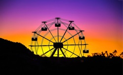 Ferris wheel sunset silhouette view. Sunset ferris wheel silhouette. Sunset ferris wheel on sky background. Ferris wheel sunset scene