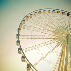 Ferris wheel with blue sky with retro filter effect