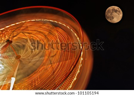 Ferris Wheel with full moon in background.