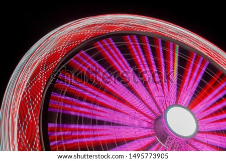 Ferris Wheel With Motion Blur. Close up of Ferris Wheel With Motion Blur #1495773905
