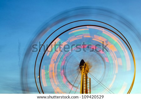 Stock Photo Ferris wheel with motion blurred lights
